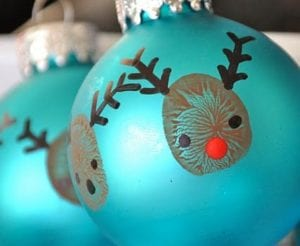 An ornament activity for kids. This ornament has a fingerprint reindeer on it