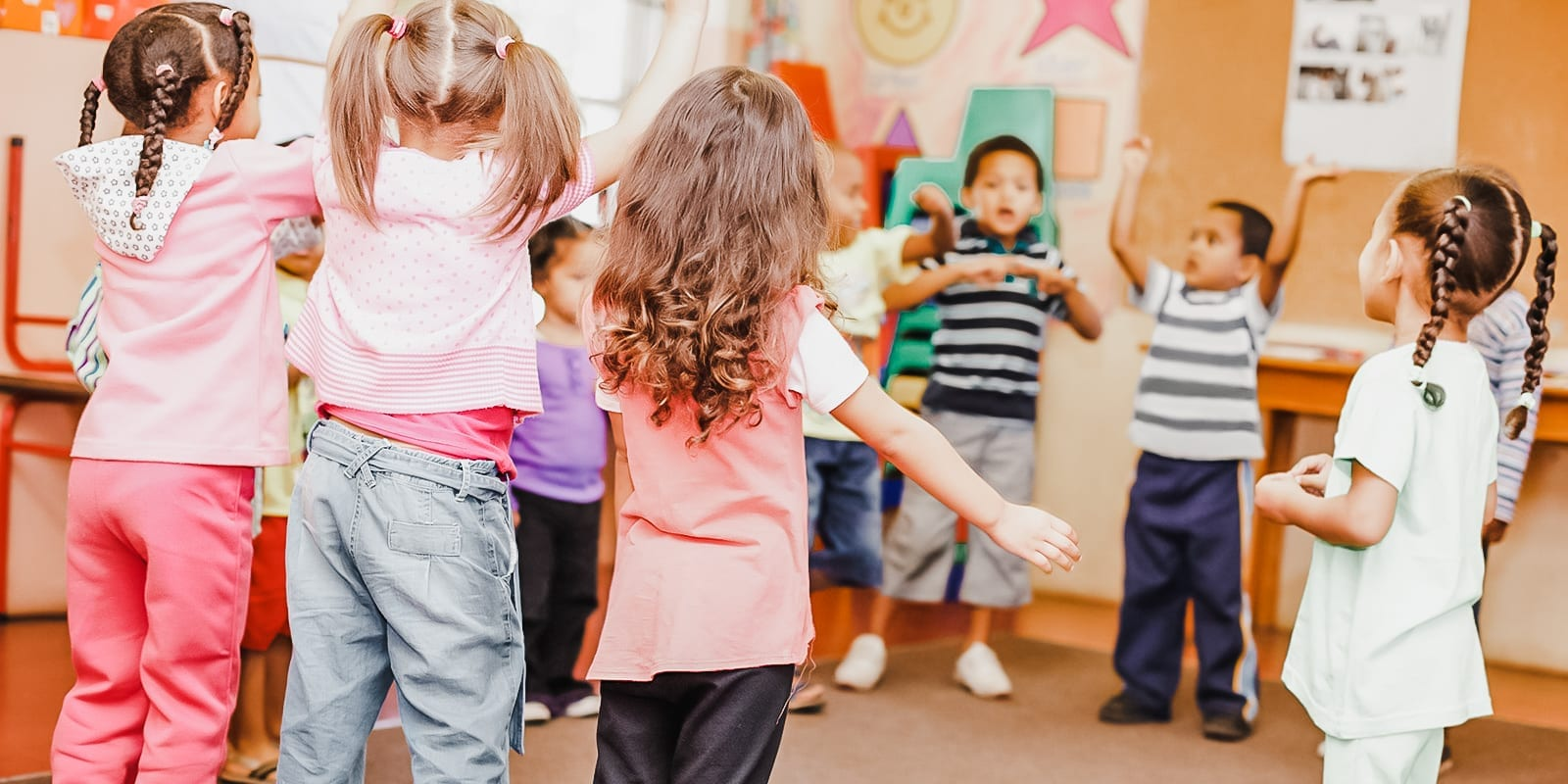 A preschool class dancing in the classroom