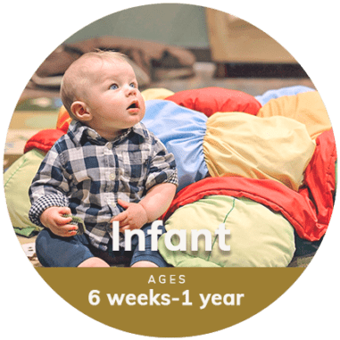 Infant sitting on mat at Little Sunshine's Playhouse and Preschool